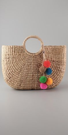 i have this bag!  just need to make some pom poms...