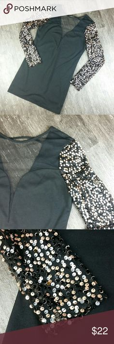ENGLISH ROSE LARGE Inventory#C57  ENGLISHROSE BLACK GOLD SEQUIN MINI DRESS, SHEER CHEST & BACK LONG SLEEVELARGE Sheer chest over plunging neckline.  Sheer deep V back.  This is in excellent condition.  Such a cute and sexy little dress! English Rose  Dresses Long Sleeve