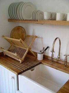 "Pinner says, ""Image detail for -... beech floating shelf becomes a plate rack over the draining board."""