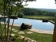Infinity pool + farm land=perfection!  Who says you need a lot of hardscape and decking!