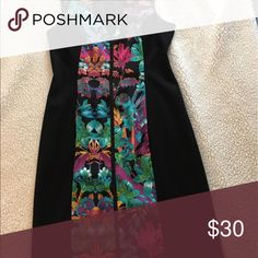 """Nicole Miller dress NWT Nicole Miller - black with flattering floral design - front has black mesh v-cut at neck, open back  38"""" from shoulder to bottom hem. Can be paired with heels for special occasion, or with flats for more casual theme. Material is light and comfortable Dresses"""