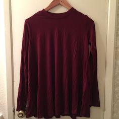Long sleeve maroon top Long top with long sleeves. Would look super cute with leggings! Never worn Forever 21 Tops Tees - Long Sleeve