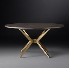 $$$ but beautiful. no doubt Maslow Spider Round Dining Table