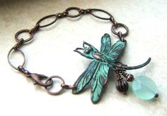Rusty black dragonfly charm with verdigris patina applied and then lightly sanded.