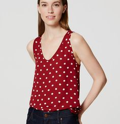 In cooly etched spots, a mix of knit and woven textures freshens up this pared-back tank with modern appeal. Rounded V-neck.…