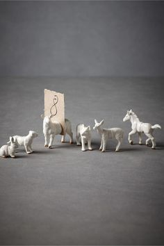 This could be an easy DIY. Buy a bag of plastic farm animals, saw them in half, spray paint, magnets.