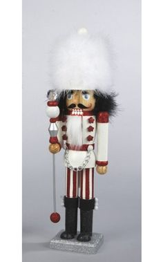 """$39.99-$49.99 From the Peppermint Twist Collection Item #C0700  Add a festive sparkle to your holiday decor with this red and white glitter drenched nutcracker Features plush feather hat and hair, deluxe cotton beard, candy cane striped pants, red star jacket """"buttons"""" with a silver chain, and holds an ornate scepter For decorative purposes only Comes gift boxed  Dimensions: 17.5""""H x 4""""W x 3""""D M ..."""