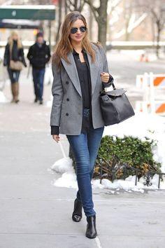Grey coat, gray, black top, blue jeans, black shoes, black leather bag.