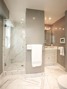 Marble takes an ordinary bathroom from bland to brilliant by bouncing the light around to make even a small bathroom feel much brighter and more spacious. Contractor Stephen Fanuka of Million Dollar Contractor uses oversized marble tiles on the floor and in the shower to create this lavish bathroom.