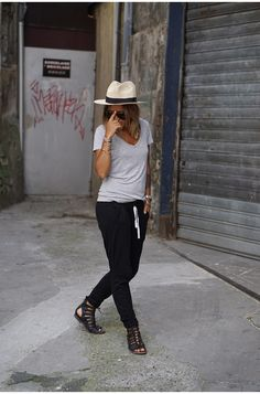 An all-black jogger and tee outfit allows for an easy yet stylish overall look. Nicoletta Reggio wears these joggers with simple black sandals. Pant: B, T-Shirt: H&M, Sandals: Sarenza, Bag: Saint Laurent.