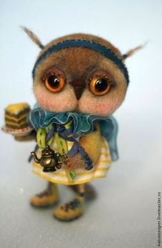 Love!  Cute little needle felted owl by Olga Dmitrieva from Russia.  Go check out her other owls = adorable!