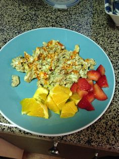 Whole30 day 4 Breakfast- eggs 2 with Chalula and Oranges and strawberries