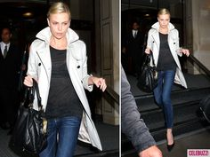 Charlize Theron. Love the trench coat.
