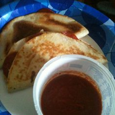Pizza quasadilla-used pizza cheese and pepperoni in a tortilla-dipped it in pizza sauce! Easy quick snack!