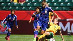Alanna Kennedy #14 of Australia lide tackles Yuki Ogimi #17 of Japan