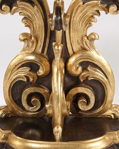 Baroque style   console   late Baroque style carved wood console table with antique brown finish and antique gold leaf trim