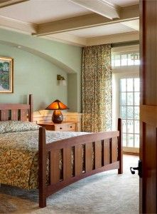 In the master bedroom, the Morris-designed fruit pattern was used for the tailored spread and drapery. The inlaid bed is a Harvey Ellis design reissued in cherry by Stickley.