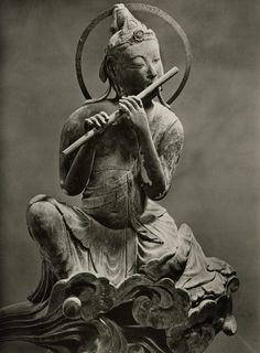 """A Musical Bodhisatva: Photo by a Japanese photographer, from a 1966 portfolio of photos of """"The Byodo-in."""" ."""