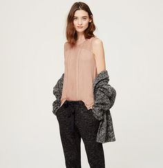 Starring a lace yoke, this soft jersey piece packs and effortlessly pretty punch. Round neck. Sleeveless. Lace front yoke and panel. Ladder-stitch trim. Side slits.