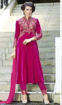 Flaunt your style in this pink color embroidered velvet Anarkali pant style suit. This stunning attire is showing some incredible embroidery done with lace and resham work. #velvetanarkalidress #fullsleevesanarkali #anarkalionline