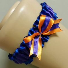 Royal Blue Wedding Garter - a royal blue and purple garter, fitted with an adorable custom made purple and orange bow. One-of-a-kind! by HemHouse on Etsy