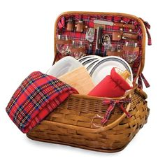 The Highlander picnic basket may make you feel like youre enjoying an outdoor meal in the highlands of Scotland, with its quilted red tartan lining and blanket. The Bombay-style basket leaves plenty of room for food and drinks, and has a complete service for four strapped inside. Never bother with plastic and paper again, when you have pretty plates and napkins that match your basket perfectly! You even get picnic items like salt and pepper shakers, a wine duffel and ... osceolaflyer