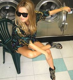 glitter sequin dress long sleeves green gold black studs studded heels shoes blonde girl sunglasses glasses style fashion