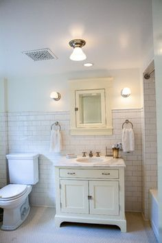 Queen Anne Basement bathroom with white ceramic subway tile