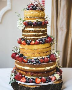 4 tier naked wedding cake with fruit & flowers created by Sugar Wishes Cakes