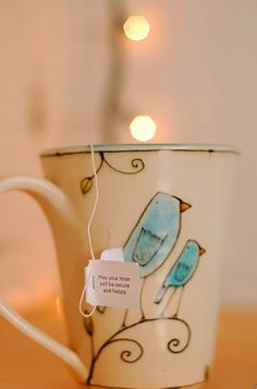 that's cute, drinking tea with a inspiring message.