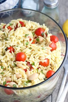 This lemon orzo pasta salad is just the thing for spring and summer! It's loaded up with fresh basil, chopped sliced almonds, white beans, and lemon juice.