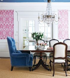 this is what i meant by framed fabric... also - would you ever consider doing 2 different chairs at the ends of the table? could balance the casual sense with a slightly dressier wingback (not this dressy, or velvet necessarily...) just a thought