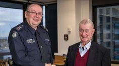 Chief Commissioner Graham Ashton with Denis Ryan.