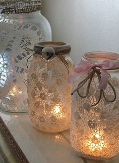 lace and old jars. very pretty