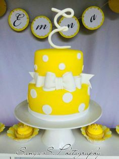 Polka dot cake at a yellow vintage Birthday Party! See more party ideas at CatchMyParty.com!