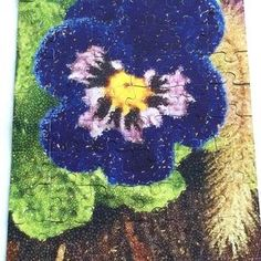 Blue pansy puzzle. Vintage looking bold and bright pansy puzzle brings nothing but pure fun and warm rustic feel to your home. Skill level: Intermediate.