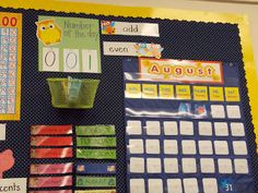 Great first grade classroom set up: math meeting area, number posters, phonics dance...