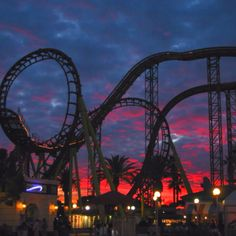 Oh how I love roller coasters :D Even better during sunsets, or in the dark!
