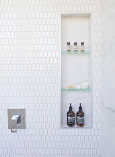 A great way to add storage and style to a bathroom is by creating a shower niche. A shower niche replaces the need for a corner shelf or a hanging caddy, and adds a luxurious touch to the bathroom. Bathroom Niche, Modern Bathroom, Master Bathroom, Tile Shower Niche, Bathroom Images, Bathrooms, Bathroom Lighting Design, Bathroom Light Fixtures, Shower Shelves