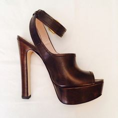 """2X HOST PICK! •• Miu Miu Brown Wooden Heels 100% Authentic Miu Miu strappy wooden heels. Wooden platform and heel with brown leather front and strap. 5.5 inch heel. About 1.5 inch platform front. Practically brand new. No marks or discoloration. Only worn around my house once. ••• Trades PayPal  Featured on Poshmark's Instagram • 04/02/15  ✨✨Host pick • """"Insta Chic"""" • 03/30/15✨✨  ✨✨Host Pick • """"Style Staple"""" • 04/04/15✨✨ Miu Miu Shoes Heels"""