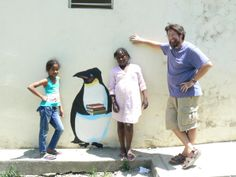 Working on a mural for the school in Cangrejo with help from Mary and Iesa.