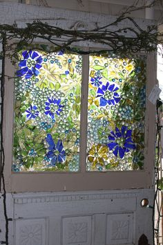 Mosiac window made with broken colored glass and glass dots from the dollar store