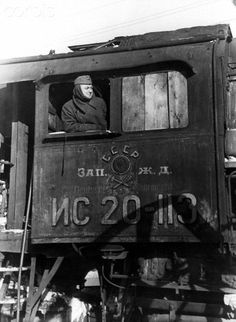 A German railway employee is pictured in a captured Russian locomotive in the locomotive depot in Smolensk, Russia, in February 1942. Next to the Russian writing, the words Deutsche Wehrmacht are printed.