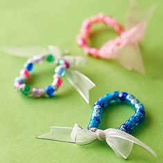 Playing dress-up just got more glamorous. These simple beaded bracelets take minutes to make and are sure to inspire hours of fun.                 Make It: Cut a 2-foot-long piece of 1-inch-wide ribbon.* Tie a double knot about 6 inches from one end and begin adding beads. This is a perfect time to teach your child how to create patterns with the beads she chooses. Measure around her wrist as you string so you make the bracelet the correct size. When you're done, tie a double knot against…