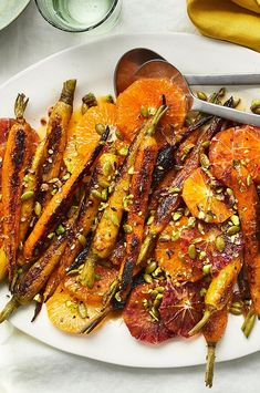 Colorful carrots and citrus plus green pistachios and pepitas means this high-fiber vegan side dish hits practically every color of the rainbow and offers a multitude of flavors and textures. #healthyrecipes #healthyeating #health