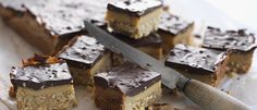 Peanut & Caramel Chocolate Slice recipe from Food in a Minute Chocolate Slice, Chocolate Caramels, Food In A Minute, My Favorite Food, Favorite Recipes, Golden Syrup, Cupcake Cookies, Cupcakes, Healthy Treats
