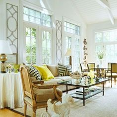 deluxe-white-airy-spring-living-room-decor-with-big-windows-brown-sofa-yellow-pillows-lamp-hardwood-floor-and-carpet-decor.jpg 480×480 pixels