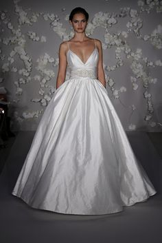 Wedding dress:  Ball gown, deep plunge neck ahhhh so dramatic!