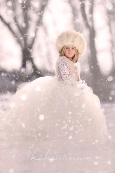Ice Queen flower girl for a winter wedding. HEAD-TOE: Super cute and warm fluffy fur hat, shaggy fur vest over a lacy illusion sleeve top, warm furry gloves or muff, big puffy princess tulle skirt. Any warm boot will do, your dress will cover them.