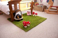 This is such a lovely idea for a garden themed baba's room; green carpet for grass a toadstools made out of felt! Easy Peasy!